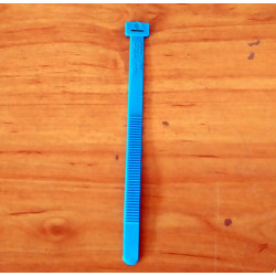Flexible plastic clamp. Blue.